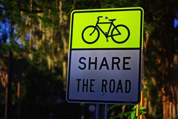 Share it if you stay on your side and use your brain to ride on streets with enough SHOULDER that I don't come around the corner and find you in your aerodynamic helmet and spandex shorts peddling into my bumper.