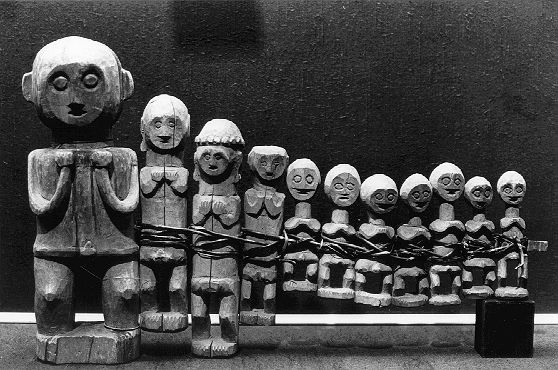 Nias, Indonesia. 'Adu' are wooden figures used to mediate between the spiritual and human realm. The figurines are believed to house the souls of deceased ancestors. They are kept in the home, where they are regularly consulted and as well decorated and provided offerings.