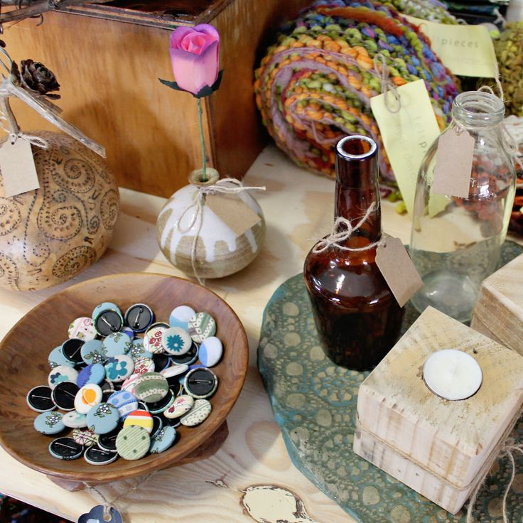 Autumn inspired display for our Recycled Gallery. A mix of vintage amber glass, pottery vessels, warm tones, hand spun/dyed scarves, patterned gourd and candle holders made from up-cycled pallets.