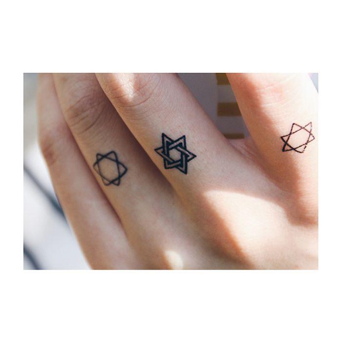 Chic Tiny Star Finger Tattoo