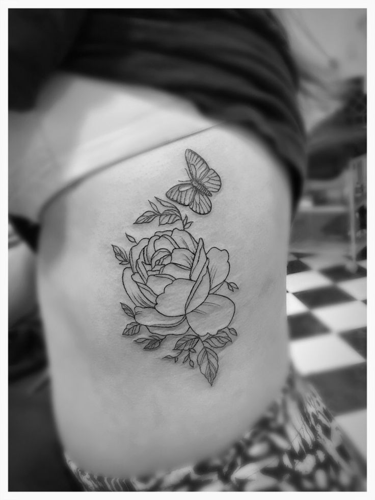 Simple and dainty peony and butterfly tattoo. Rib tattoo. Girl tattoo.