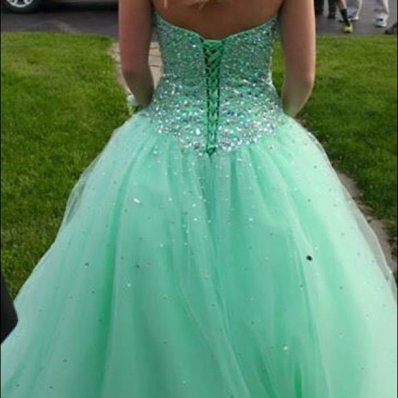 Mori Lee Prom Dress! Gorgeous Mori Lee Prom dress for sale! Will fit from a size 2-8. Corset Back. Mint green color with Jewels throughout the bodice and skirt. Comes in a Rae Lynn's Boutique bag. Mori Lee Dresses Strapless