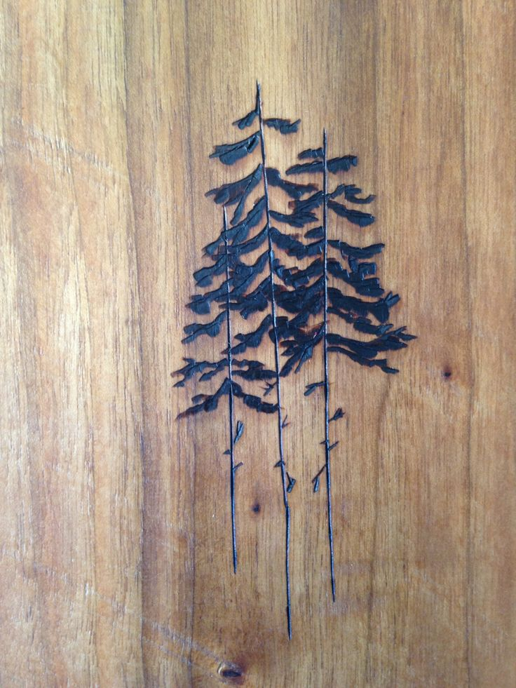 Burnt Wood Pines on Cherry Wood Cutting Board                              …