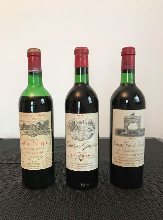 """1975 chateau Calon Segur Saint-Estephe GCC & 1970 Chateau Quentin GC Saint-Emilion & 1975 Grand Vin de Poyferré Las Cases Saint-Julien - 3 flessen (73 cl)  De partij bestaat uit 3 flessen.De 3 flessen zijn:-1 chateau Calon Segur Grand Cru klasse Saint Estephe Medoc 1975. Het label is in goede conditie de capsule is in goede staat maar heeft een beetje van de schimmel. De wijn niveau kan worden geclassificeerd als """"helft schouder"""".-1 chateau Quentin Gran Cru Saint Emilion 1970. Het label en…"""