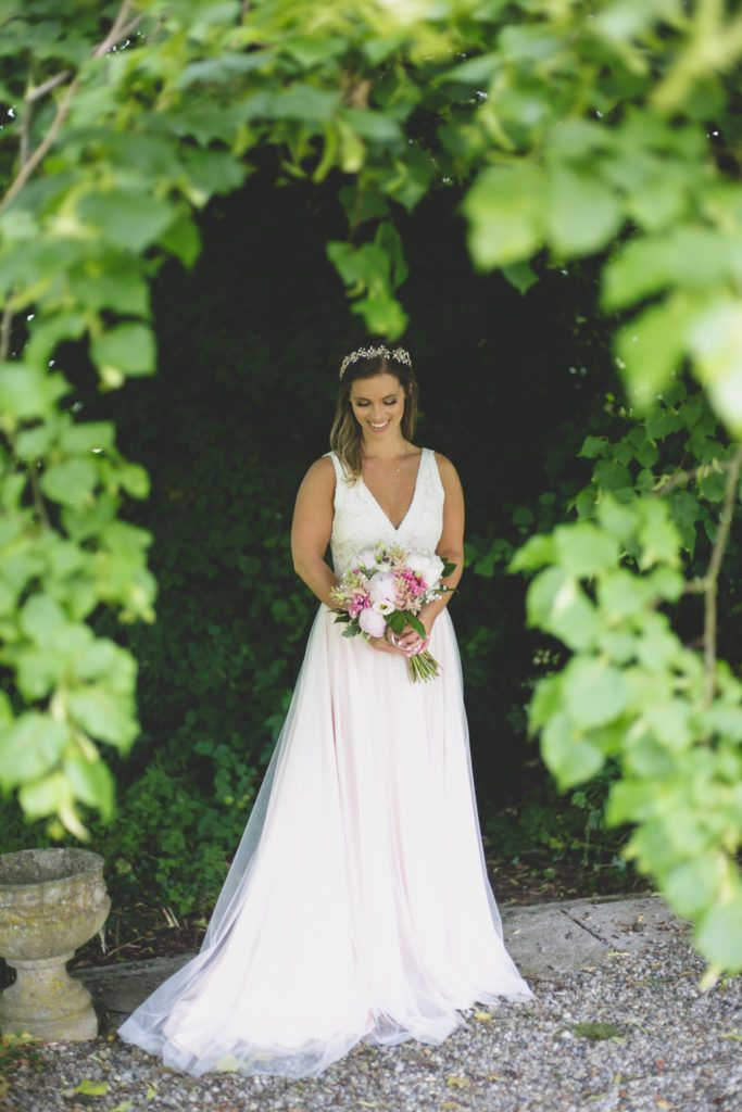 portrait of a bride is a pale champagne pink dress
