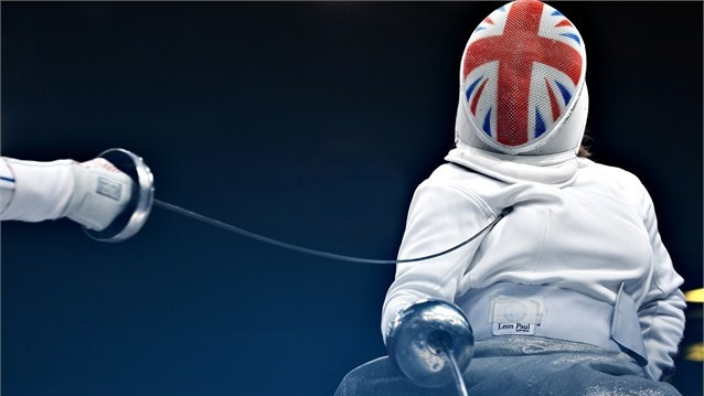 Justine Moore of Great Britain gets the point  Justine Moore of Great Britain in action during the women's Team Wheelchair Fencing - Category Open classification match between Great Britain and France on Day 9 of the London 2012 Paralympic Games at ExCeL.