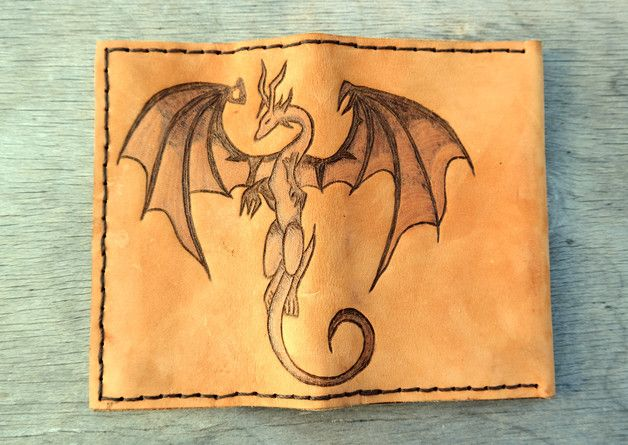 Handmade tobacco bag made from high quality soft leather with a dragon pyrography. With interior pocket for filters and exterior pocket for rolling papers. Sewed by hand by waxed...