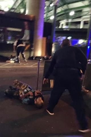 Police subdue two suspects, one apparently wearing a bomb vest