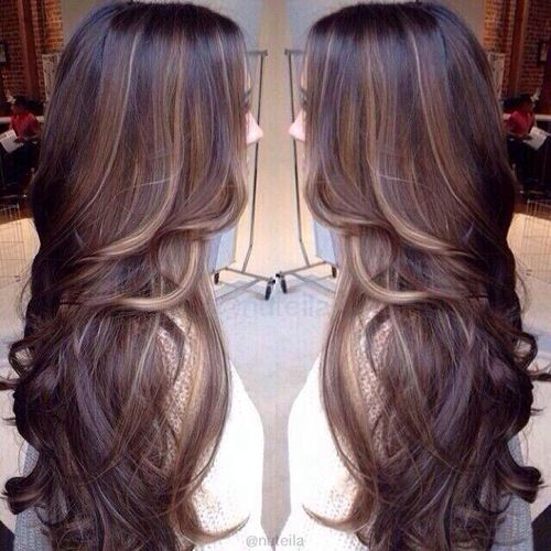 Black hair with brown and caramel highlights.