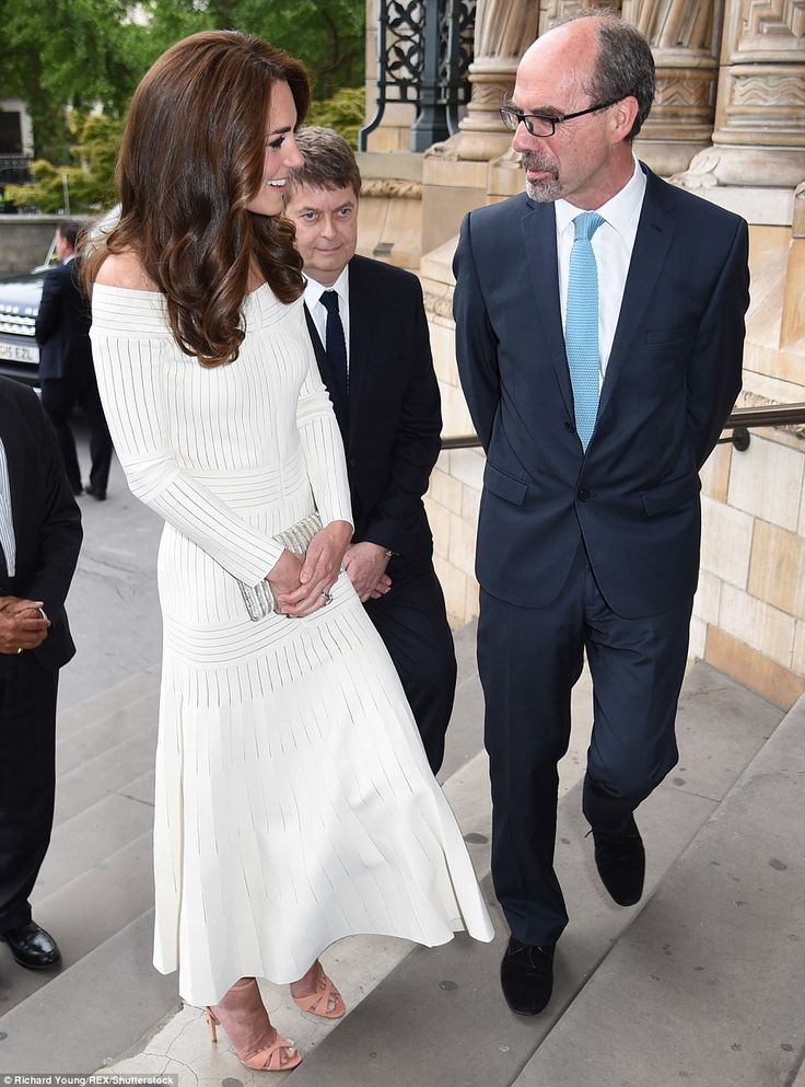 Kate smiles as she arrives for the awards ceremony and chats to Stephen Deuchar, right, Di...