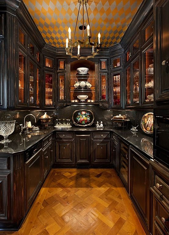 Ultimate Butler's Pantry - lots of lighted glass cabinets and places to store china, serving dishes, trays, silver, candlesticks, linens, and more!