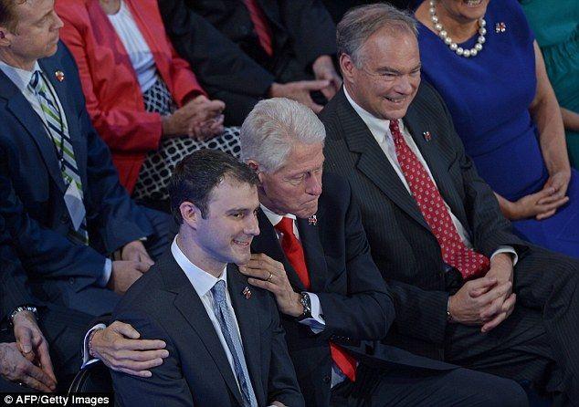 Chelsea's husband Marc Mezvinsky (left) sat next to her dad, former President Bill Clinton (center) and her mother's running mate, Virginia Sen. Tim Kaine
