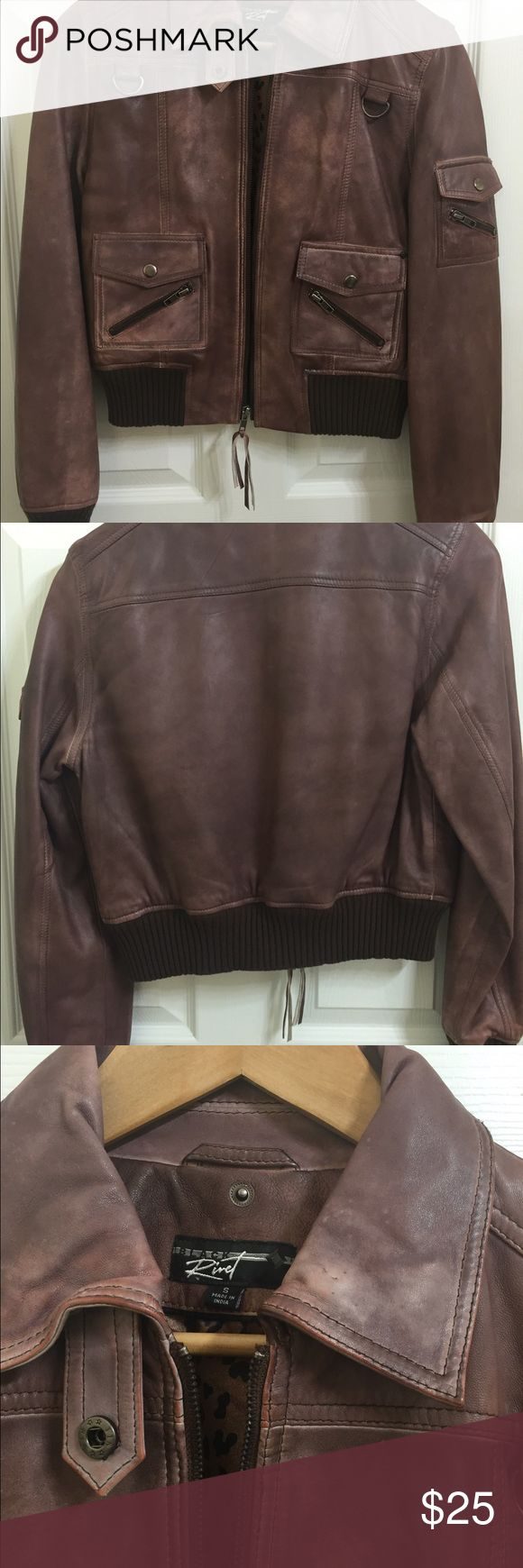 Leather bomber jacket Brown leather bomber jacket. It has some discoloration due to storage, but other than that it is in great condition. 100% leather. black rivet Jackets & Coats Utility Jackets