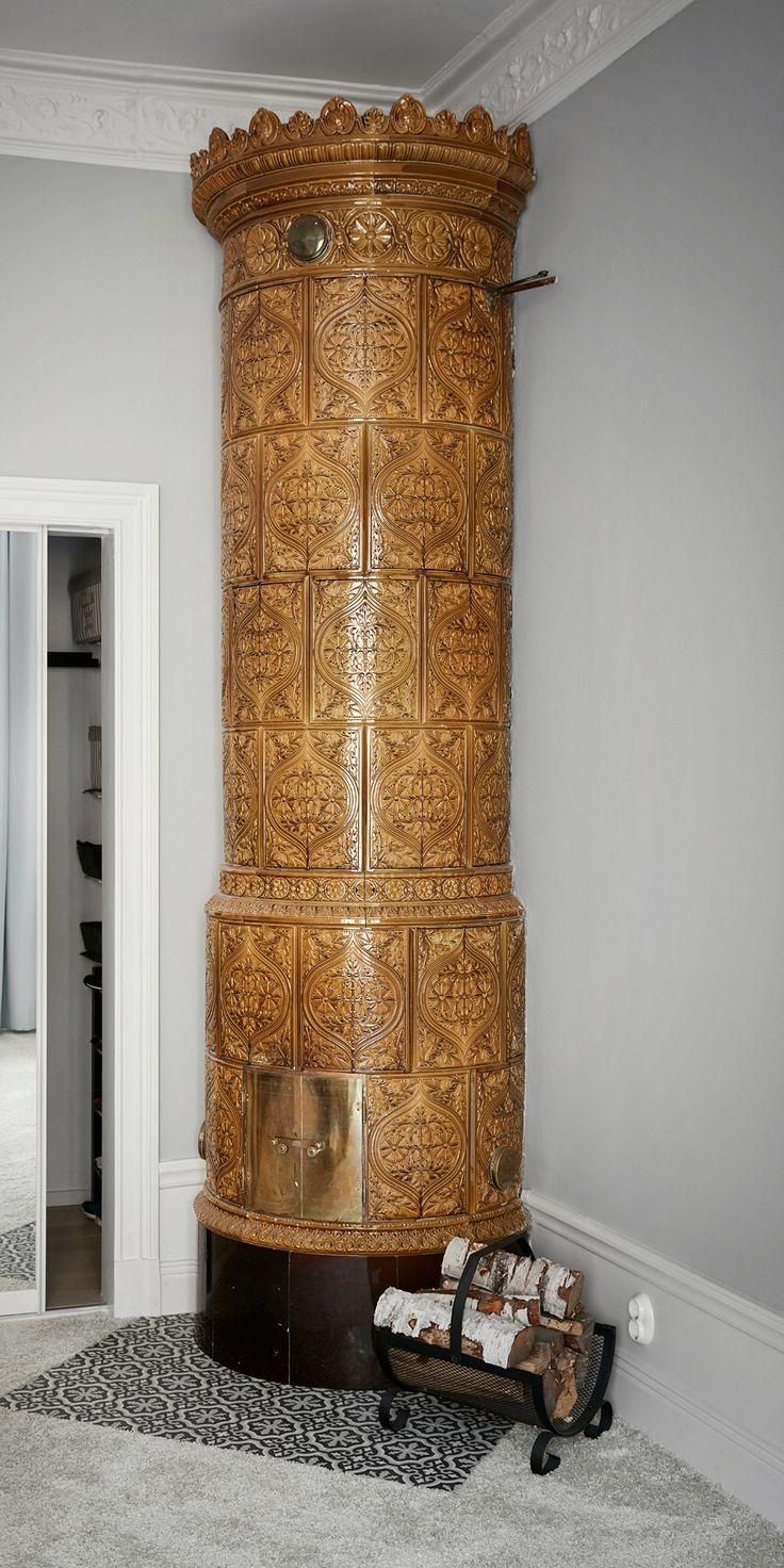 Mustard coloured ornamented stove. P.H Lundgrens Kakelugnsfabrik (tiled stove manufacturer) Stockholm, ca 1895. Height 285 cm.