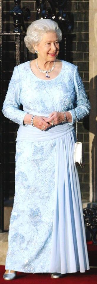 Queen Elizabeth posed with then British Prime Minister Tony Blair in a pleated periwinkle gown and sapphire jewelry.