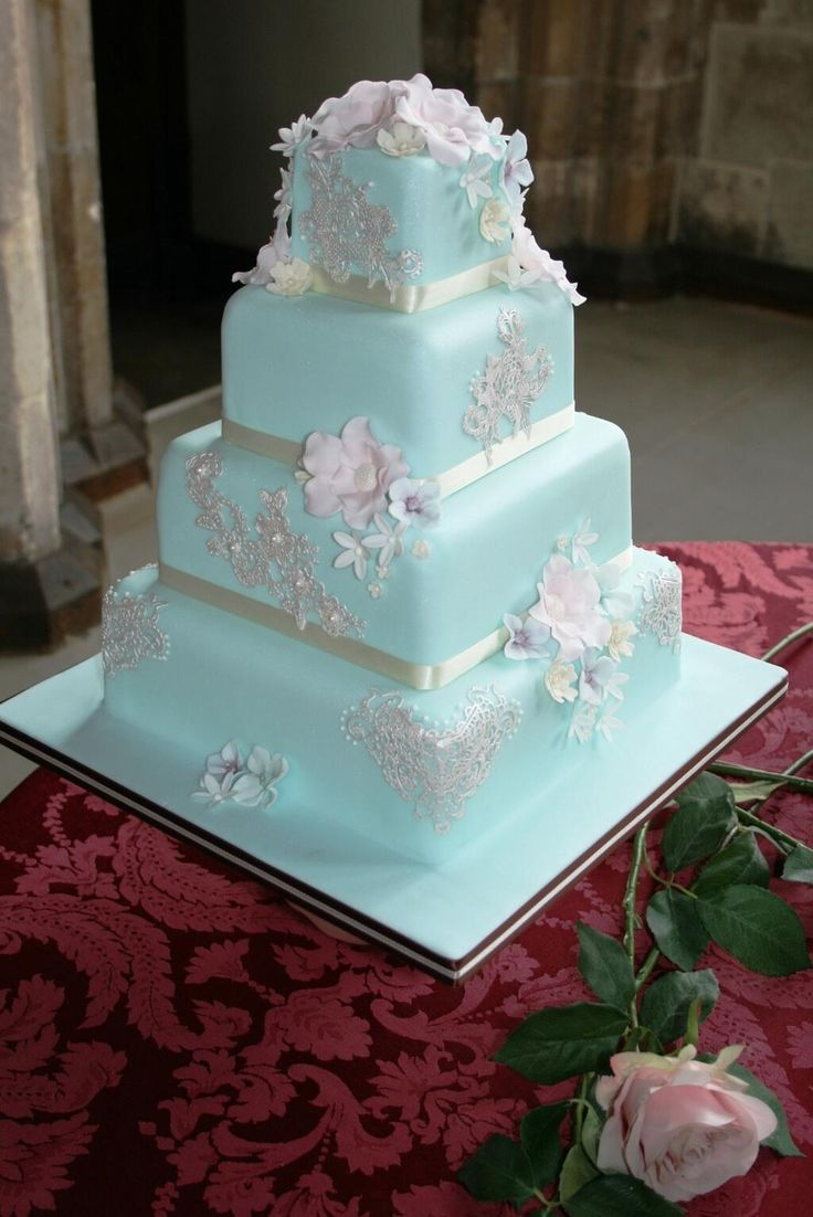 Pretty Duck Egg Blue Wedding Cake With Pastel Flowers And Pearl Lace