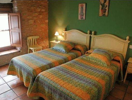 Alluring La Cuculla Inn with its Exotic Vibe : La Cuculla Bedroom Green And Orange Color