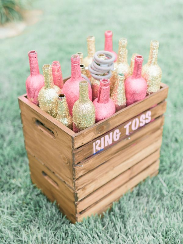 """Put a Ring On It"" Bachelorette Party Ring Toss Game: Feel free to play Queen Bey while you challenge your best girls to a bridal version of horseshoes. Set up some decorated bottles (wine bottles look nice) and start throwing some large rings, hoping to ""ring"" as many bottles as possible. The lady with the best aim wins!"