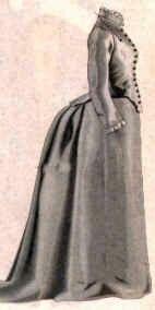 Falda con volumen en la parte trasera y plana por delante. Vestido con polisón sin escote.