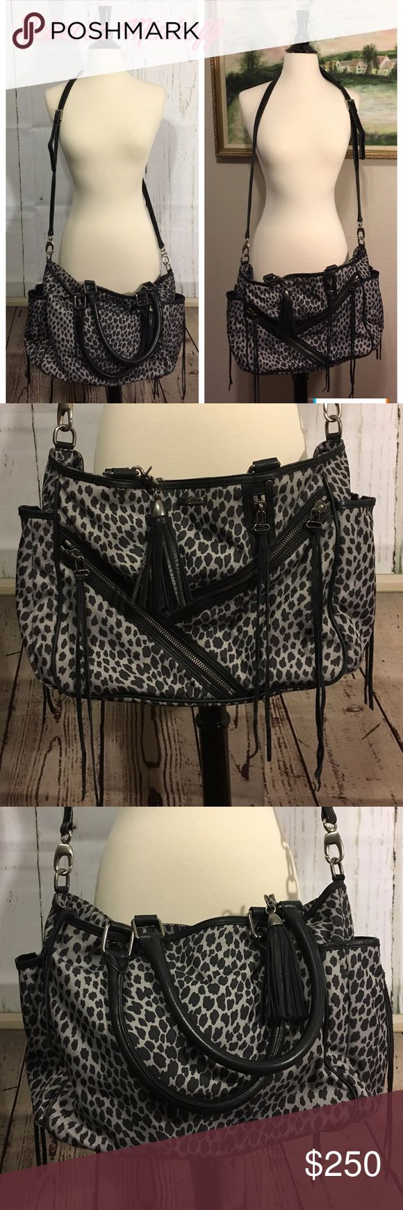 """🎀NWOT Rebecca Minkoff Crossbody🎀 Brand new, without tags, this Rebecca Minkoff  is 20"""" x 11"""" laying flat and 7 1/4@ wide. 2 large side pockets that zip to expand with the black and white material on the inside, and a leather tassel on each zipper. Shoulder straps measure approximately 19"""" and the removable cross body strap has padding with silver hardware and is adjustable, measuring 48"""" with another 4"""" extension. The front of bag has zig zag zippered pouches, each w/a leather tassel…"""