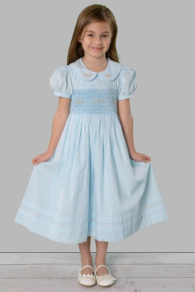 Our sweet Madison has style and grace withheart patterned hand smocked bodice androsebud embroidery onthebodice and collar. Piping on the...