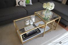 Looking for something different for your coffee table, layer a side table over it like this.