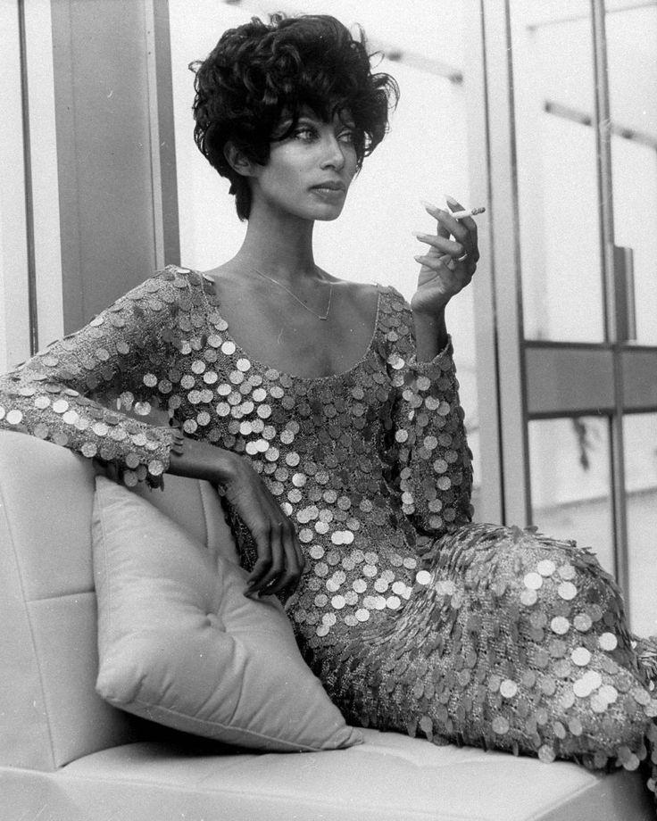Model Donyale Luna on break during a fashion shoot, 1967.