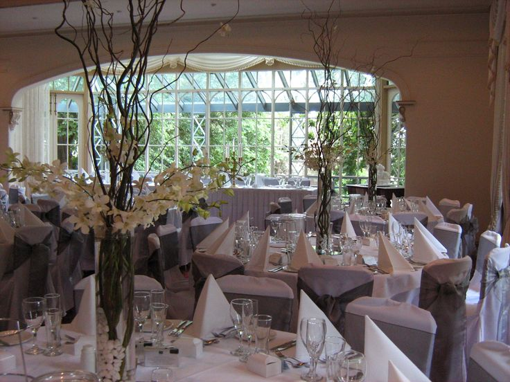 Reception setup with tall vase and sticks