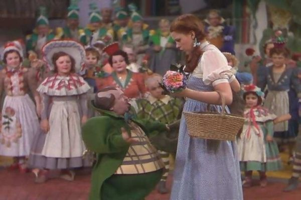 Dorothy With The Munchkins - the-wizard-of-oz