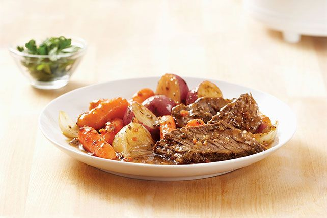 It takes just 10 minutes to get this meal into the slow cooker in the morning. When you come home: New England-style pot roast, ready to serve!