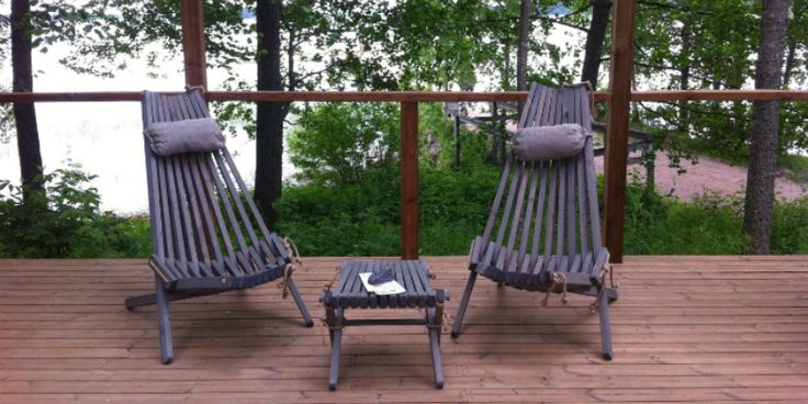 Gray stained Nordeck garden chairs at a lakeside terrace