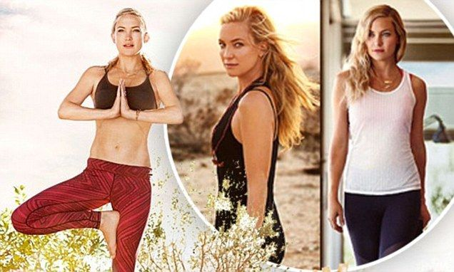 Kate Hudson displays washboard abs as she models her new fitness line