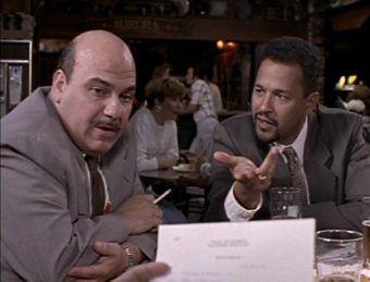 Detectives Steve Crosetti (Jon Polito) and Meldrick Lewis Clark Johnson), his partner