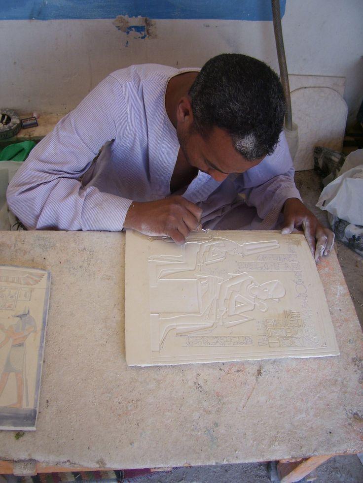 Artisan at work...beautiful tiles and pottery