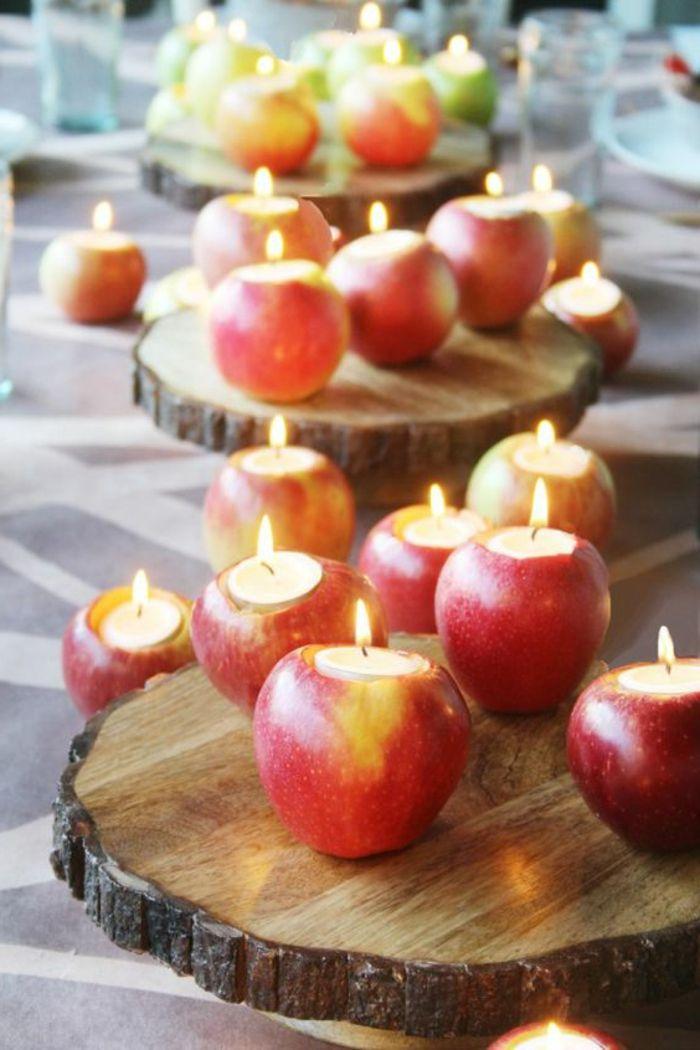 tischdeko, viele äpfel, holzunterlagen, kerzen, teelichter