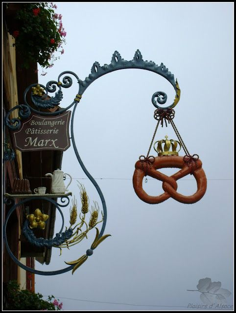 Eguisheim, Haut-Rhin (France)---Ok who doesn't need a pretzel with a crown on it to lure them in to a bakery!!!