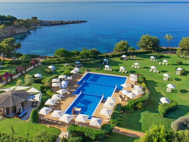 Just a short stroll from the shopping and dining of posh Puerto Portals, the waterfront St. Regis Mardavall Mallorca Resort is an amenity-seeking vacationer's paradise.