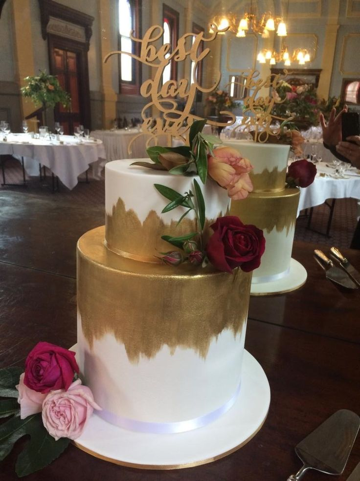 """Double barrel wedding cake: 7"""" white mud on 10"""" double barrel white mud. These cakes were filled with white chocolate ganache and covered in fondant then decorated with edible gold paint, fresh roses and wooden topper. www.facebook.com/cakesbyleannerhodes"""