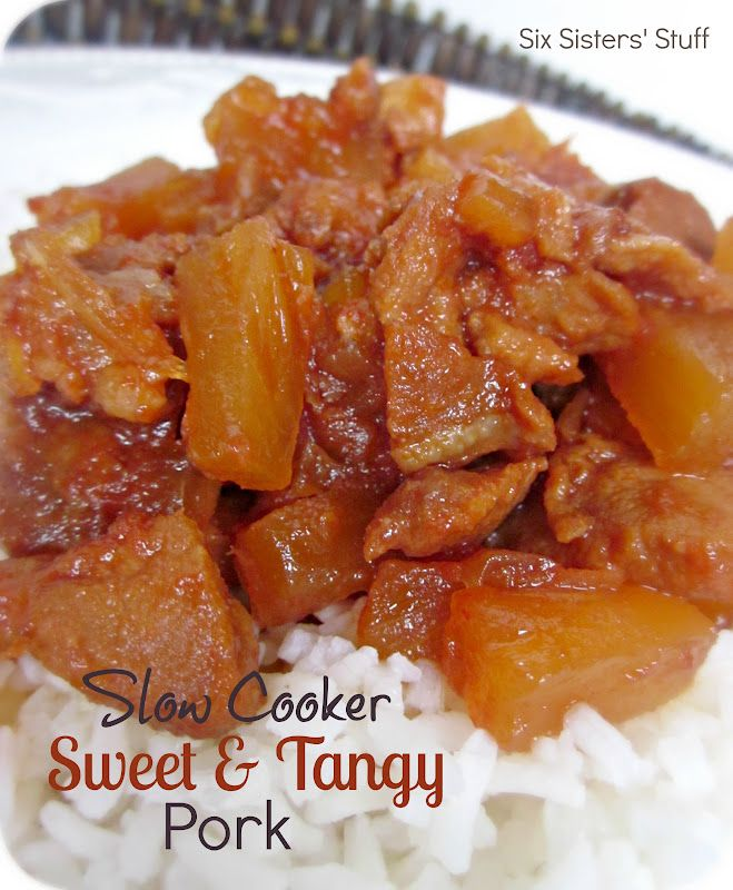 Slow Cooker Sweet and Tangy Pork from sixsistersstuff.com.  Mix all the ingredients together in your slow cooker and you have an amazing meal by dinnertime! #recipes #slowcooker #pork
