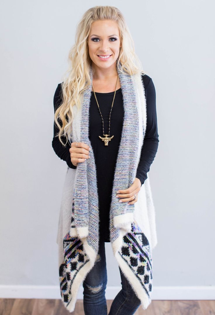 """This beauty will have you falling love with this chilly weather! Add a pop of color to your fall wardrobe with this gorgeous aztec print vest. 50% Polyester, 50% Acrylic Model is 5'7"""" size 2 in a smal"""
