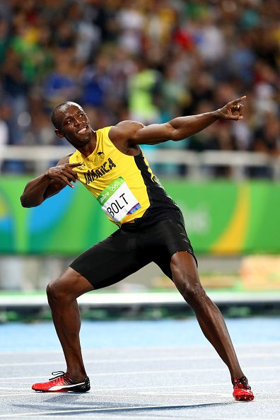 Usain Bolt of Jamaica celebrates winning the Men's 200m Final on Day 13 of the…