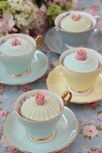 Cupcakes in teacups.  Love the little rose on top.