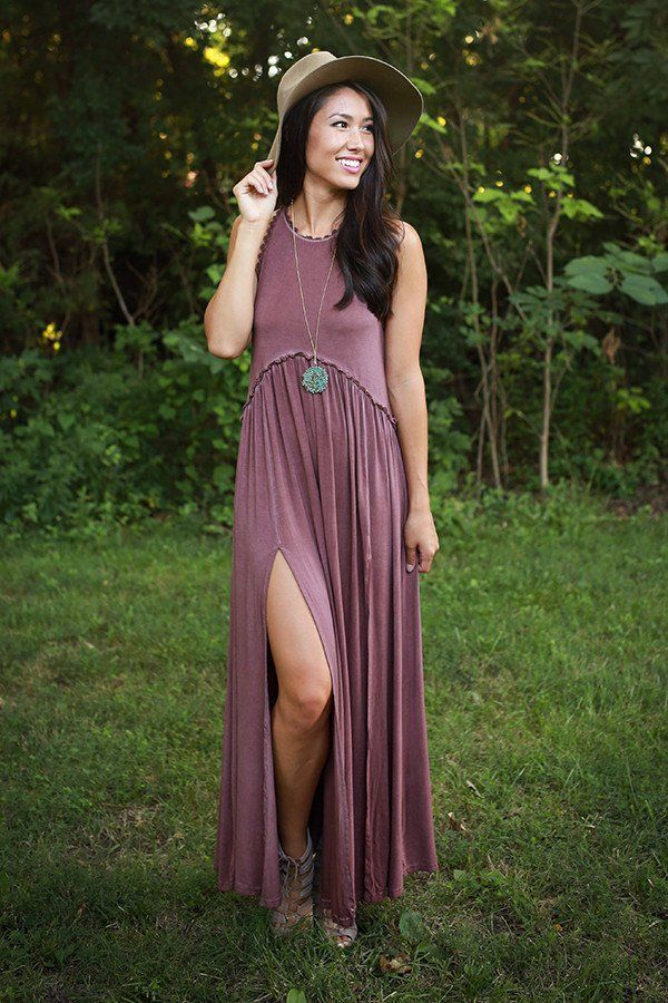This dress is fit for a queen! We love the flirty side slit and just how perfect it looks when paired with a floppy hat. This dress is perfect to transition from summer to fall.