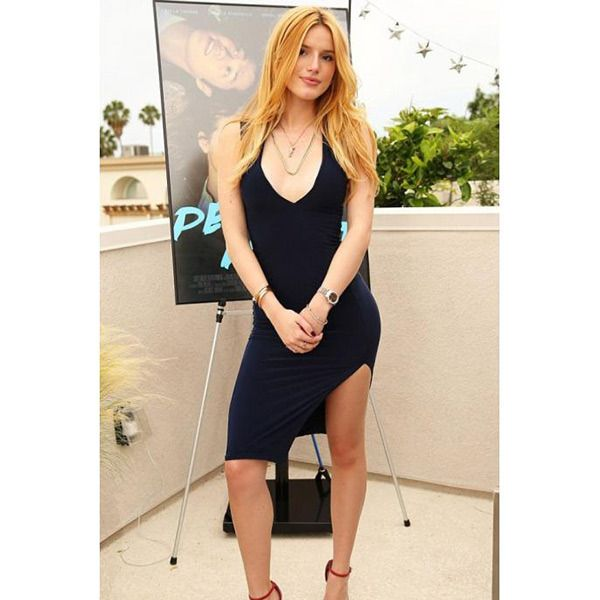 Bella Thorne donned a tight black dress with a sexy slit at the premiere party for her new movie, Perfect High, in LA. If there's one thing we love about Bella, it's that she is an affordable shopper & you can SHOP for this bargain buy here.