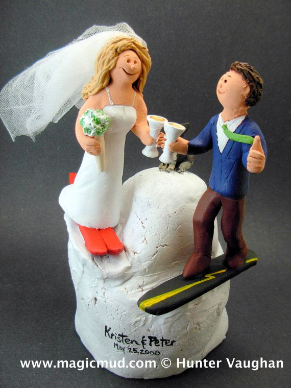 Bride and Groom on Skis Wedding Cake Topper      Wedding Cake Topper for Skiers , custom created for you! Perfect for the marriage of a Skiing Groom and his Bride!    $235   #magicmud   1 800 231 9814   www.magicmud.com