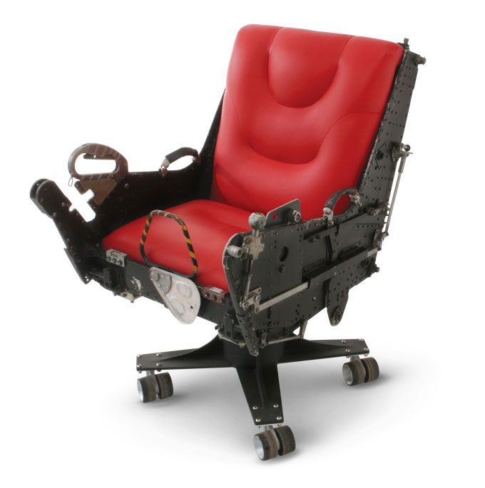F-4 Ejection Seat    Break the sound barrier without ever leaving your office with the F-4 Ejection Seat. Our low riding F-4 chair has a custom fabricated aluminum base that is powder coated wrinkle black, with double wheel casters.