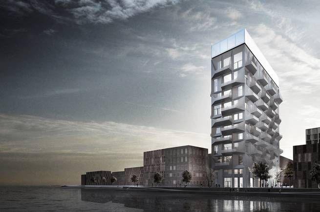 """Silon i Nordhavn är mest känd som en sliten och nerklottrad betongklump. Men nu har arkitektfirman Cobe ritat ett helt nytt hus, som kombinerar den råa betongen med glas och terasser med utsikt över Öresund, skriver News Øresund. Mäklarfirman Realmæglerne ska sälja landets dyraste lägenhet i """"The Silo"""", som projektet kallas.<br /> <b>Klicka dig vidare för fler bilder från den gamla silon!</b>"""
