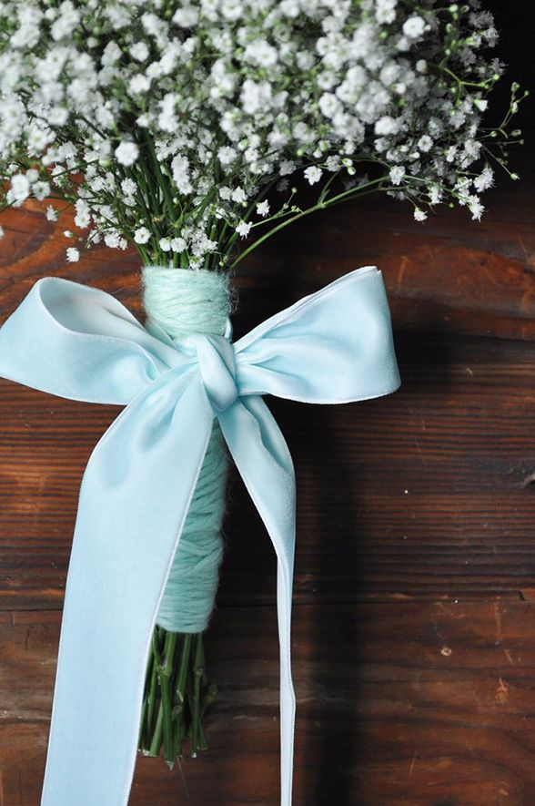 Your bouquet is a great place to tie in a little something blue. Either wrap the stems with blue ribbon or tuck one small blue flower into your arrangement.