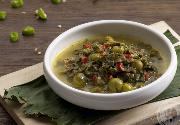 GULAI DAUN UBI TUMBUK. Pounded cassava leaves cooked in spiced coconut milk