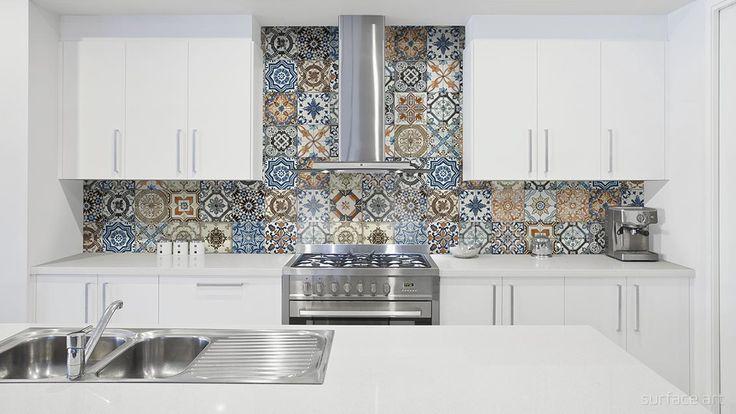 Vintage style Multi Mix tile backsplash in a white kitchen.
